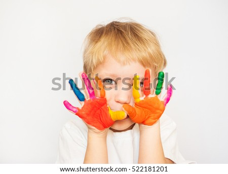 Close up portrait of cheerful funny small boy isolated on white background.