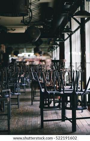Chairs and tables stacked in a closed pub #522191602