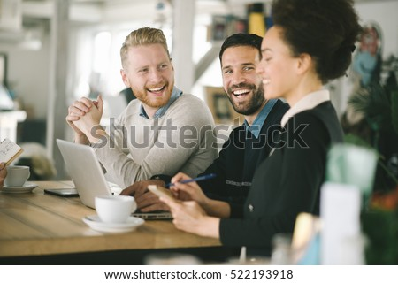 Business colleagues working together in cafe Royalty-Free Stock Photo #522193918