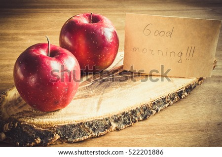 Fresh organic apples and Good morning note on on rustic wooden background. Selective Focus. Concept breakfast. Toned image.