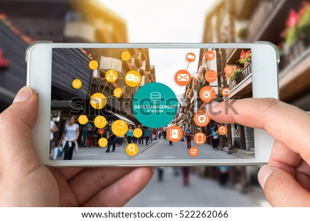 Data Management Platform (DMP) , Marketing and crm concept. Hand holding smart phone , infographic , texts and icons on retail shopping store city shop background.
