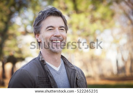 Handsome Mature Happy Man Smiling And Looking Away.Outside. #522265231