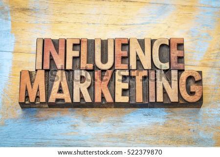 influence marketing - word abstract in vintage letterpress wood type printing blocks #522379870