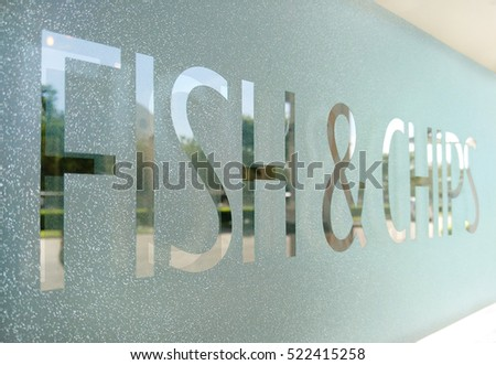 "Wording ""Fish & Chips"" sticker put on clear glasses door or window"