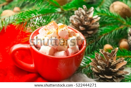 Winter Christmas decoration, fir branches and cones, marshmallows and hot drink, coffee or cacao in a cup. #522444271