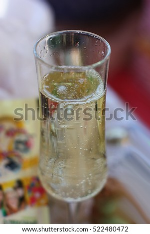 Elegant champagne glass with sparkles and bubbles #522480472