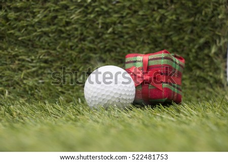 Golf ball with Christmas ornament