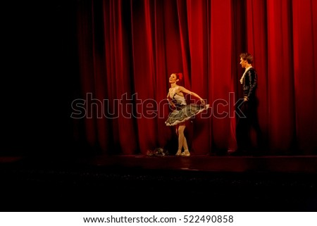 ODESSA, UKRAINE - June 6, 2013: The actors on stage of ballet Don Quixote on stage of Odessa National Opera and Ballet Theatre. Dancers and dancers in colorful costumes during show, moving motion #522490858