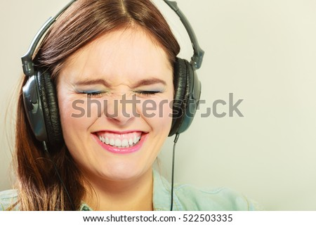 People leisure relax concept. Closeup happy woman big headphones listening music mp3 relaxing #522503335