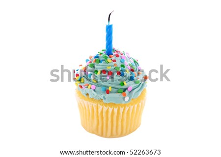 angelfood cupcake with blue frosting, sprinkles and a candle. isolated on white with room for your text or images
