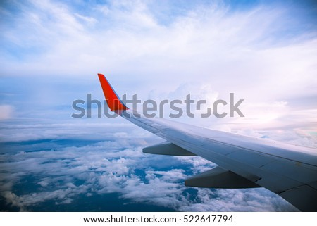 Vintage color of Morning sunrise with Wing of an airplane. Photo applied to tourism operators. picture for add text message or frame website. Traveling concept