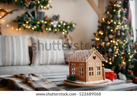 Homemade gingerbread house on background room decorated for Christmas. #522689068