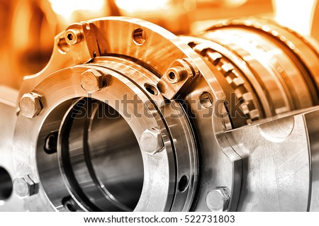 Steel parts for industrial machinery round shape. Selective toning. Close up. Royalty-Free Stock Photo #522731803