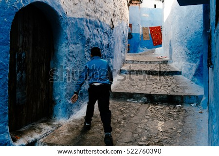 Chefchaouen Morocco - November 06 2015 -   Morrocan people walk through Chefchaouen  medina #522760390