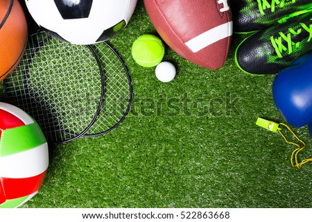 Various sport tools on grass Royalty-Free Stock Photo #522863668