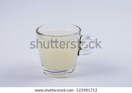 Glass of Soursop juice with copy space on white. #522981712