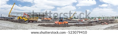 Panorama is showing a landscape transform into urban area with machinery, people are working. View on construction site.