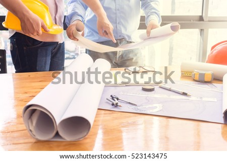 Young engineers working in the office Royalty-Free Stock Photo #523143475