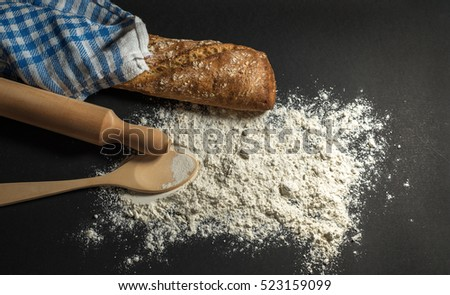 bread with flour, rolling pin and towel  #523159099
