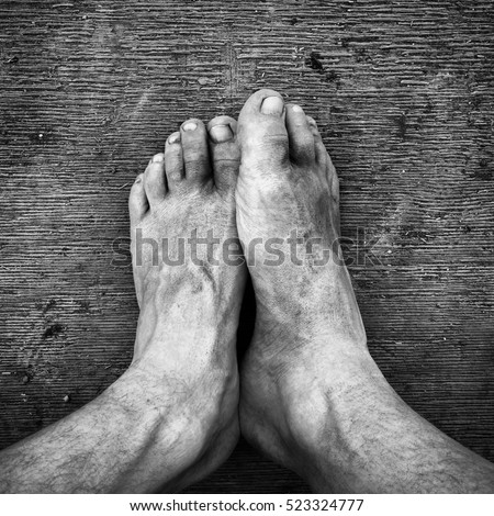 Black and white. Dirty feet on the wooden floor #523324777