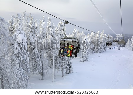 "URAL MOUNTAINS, RUSSIA - JANUARY 11, 2015. Chairlift in the ski resort ""Mountain Belaya"".  Ural mountains, Sverdlovsk region. Russia #523325083"
