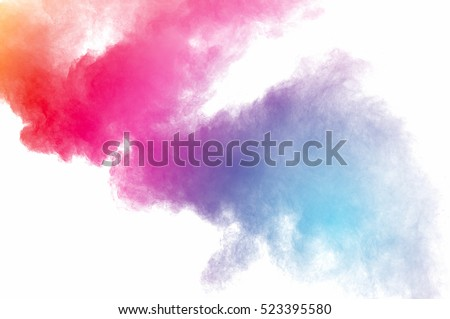 Abstract art powder paint on white background. Movement abstract frozen dust explosion multicolored on white background. Stop the movement of colored powder on white background. #523395580