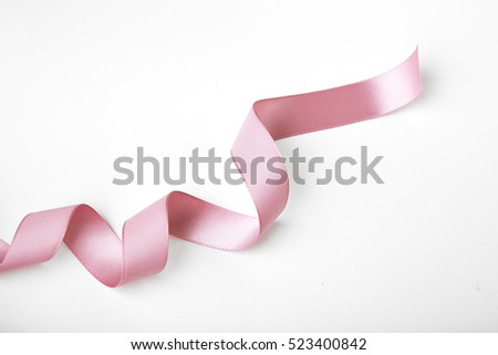 Pink curly ribbon isolated on white #523400842