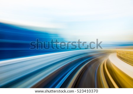 Speed motion in urban highway road tunnel  Royalty-Free Stock Photo #523410370