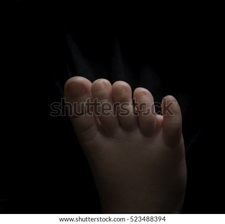 Human body parts toes and feet. Close up of mixed race baby Asian and British new born baby showing details and natural development of the human body. #523488394