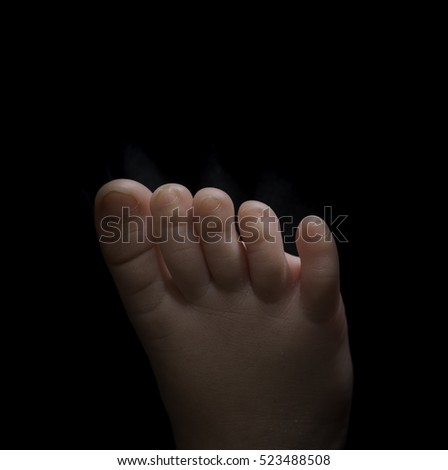 Human body parts toes and feet. Close up of mixed race baby Asian and British new born baby showing details and natural development of the human body. #523488508