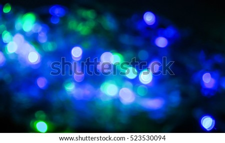 Blurry Light Background Concept : A Blurry Christmas Light in Blue and Green color #523530094