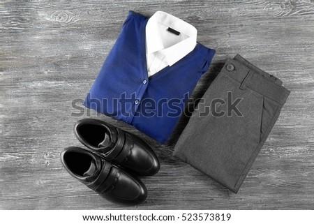 School uniform on wooden background Royalty-Free Stock Photo #523573819