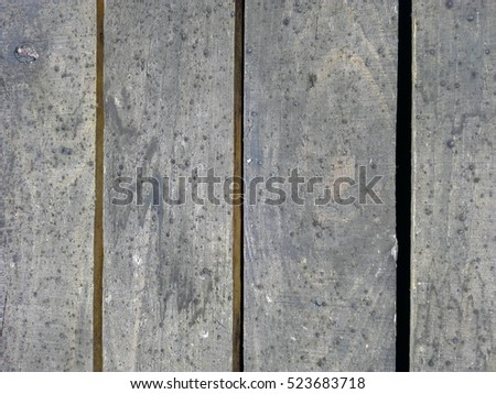 closeup Four old dirty gray boards lie next to each other #523683718