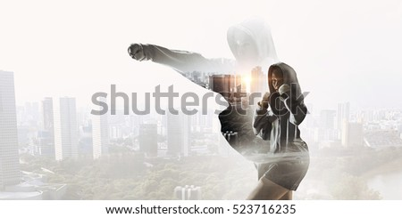 She is fighting for success . Mixed media Royalty-Free Stock Photo #523716235