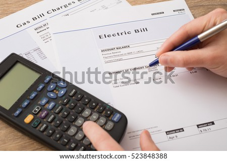 Electric bill charges paper form on the table Royalty-Free Stock Photo #523848388