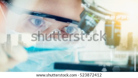 Double exposure of scientist with equipment and science experiments ,laboratory glassware containing chemical liquid for design or decorate your content,copy space,mock up. Royalty-Free Stock Photo #523872412