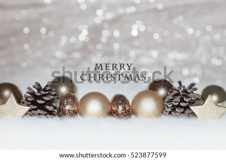 Christmas card, illustration with golden baubles, balls, decorations, ornaments on a silver white background with blurry, blurred, lights (bokeh), soft, neutral, warm colors and  Merry Christmas text #523877599