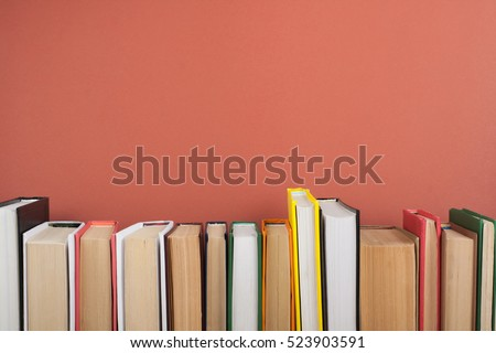 Open book, hardback colorful books on wooden table. Back to school. Copy space for text. Education business concept #523903591