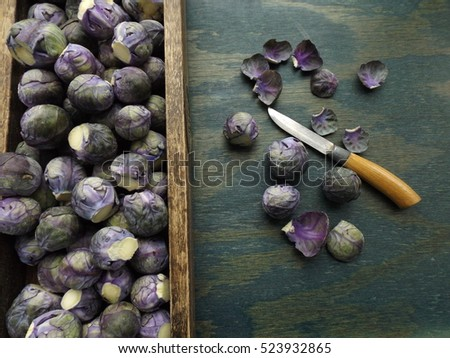 purple Brussels sprouts in a wooden box #523932865