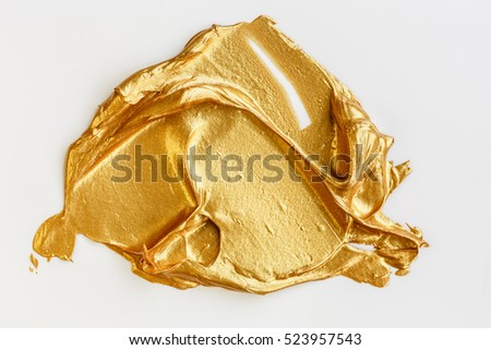 Gold acrylic paint on white background #523957543