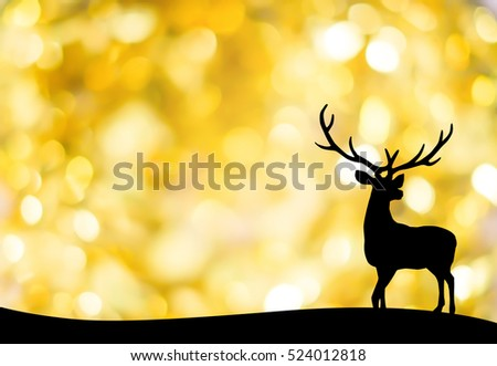 silhouette black reindeer over blurred morning sky backgrounds with sunrise lights for Christmas celebration decorate concept.