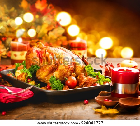 Christmas Turkey Dinner. Roasted Turkey. Winter Holiday table served, decorated with candles. Roasted chicken, table setting. #524041777