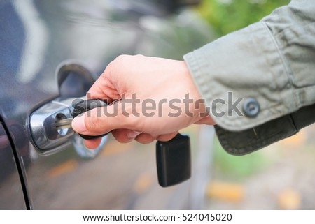 Hand on handle. Close-up of Asian man hand use car key opening / close a car door, chauffeur car service background concept #524045020