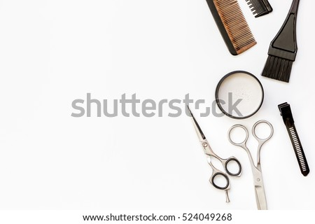 hairdresser tools on white background top view Royalty-Free Stock Photo #524049268