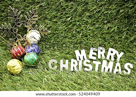 Merry Christmas to golfer with golf ball and Christmas ornament on green course background