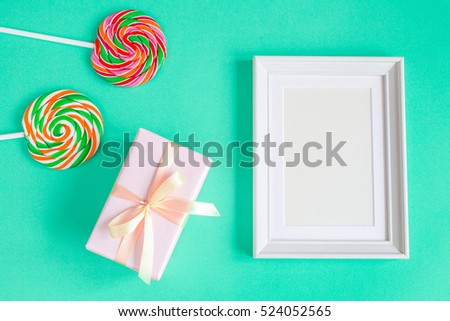 birth of child - blank picture frame on turquoise background