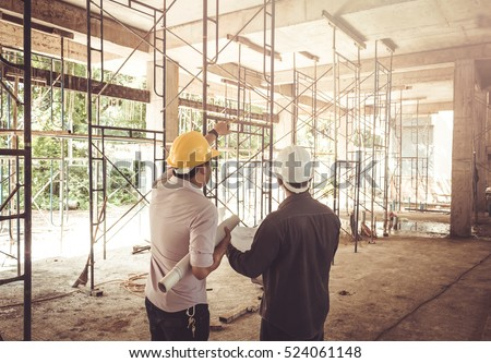 two business man construction site engineer, effect Vintage sun flare Royalty-Free Stock Photo #524061148