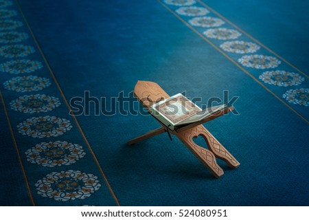 Quran in the mosque - open for prayers Royalty-Free Stock Photo #524080951