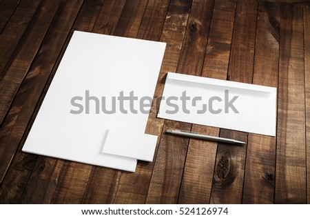 Photo of blank stationery set on wooden table background. Blank letterhead, business cards, envelope and pen. Mock up for branding identity. ID template. #524126974