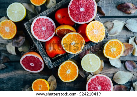 Fresh fruits. Mixed fruits background. Healthy eating, dieting. Background of healthy fresh fruits. Fruit salad - diet, healthy breakfast. pomegranate, persimmon, tangerine, banana, lemon #524210419